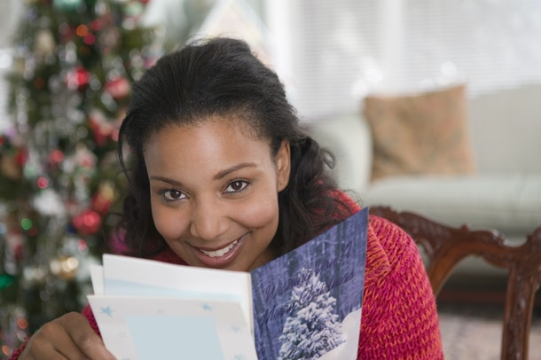 Young woman reading Christmas card