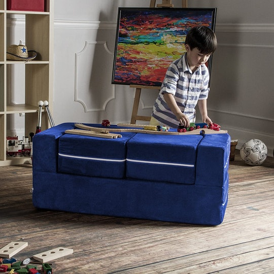boy playing with jaxx zipline kids modular ottoman