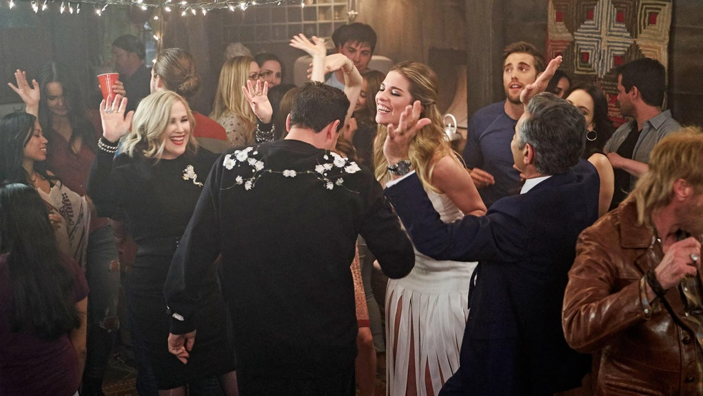 The Rose family dances at a party in 'Schitt's Creek.'