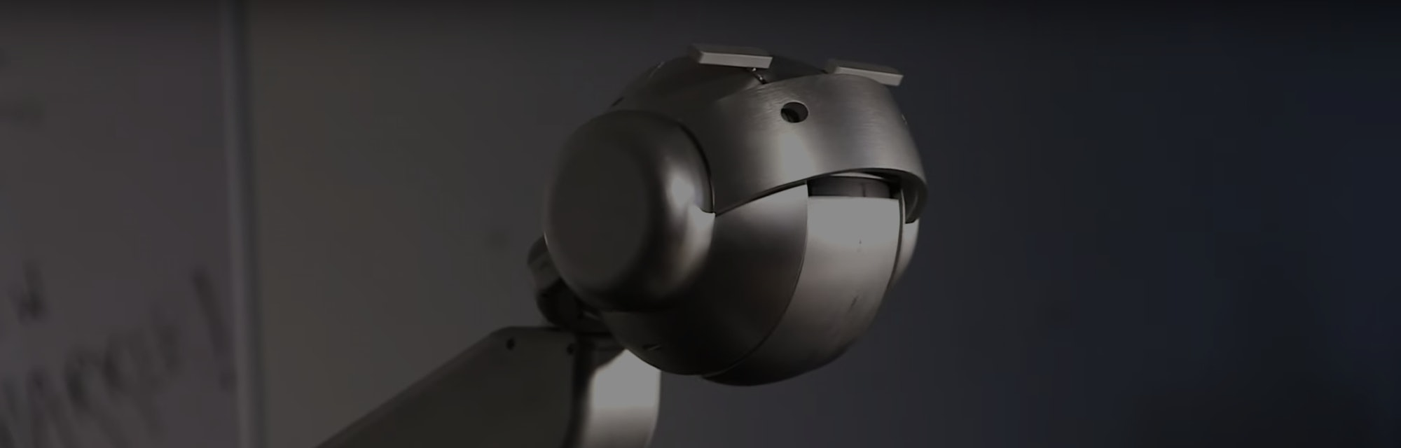 Shimon the robot, developed by Gil Weinberg, is seen mid-singing.