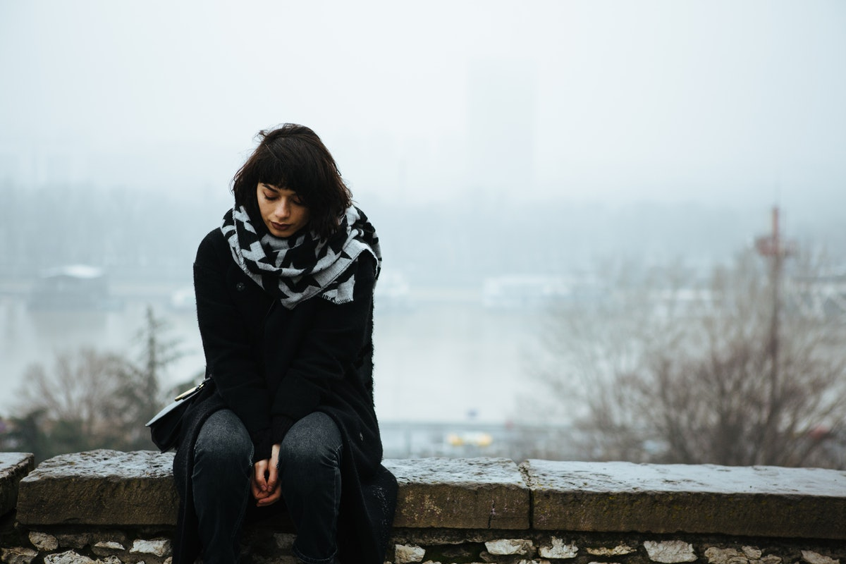 Young woman sad in December, winter