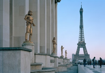 Gilded Stormtrooper statues with the Eiffel Tower in the background