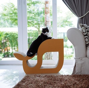 Whale-shaped cat scratcher