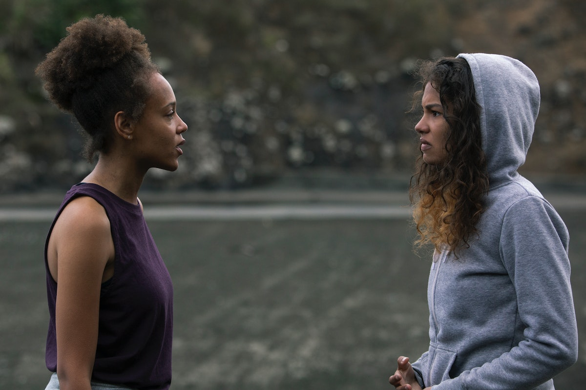 Reign Edwards as Rachel and Helena Howard as Nora in 'The Wilds' Season 1