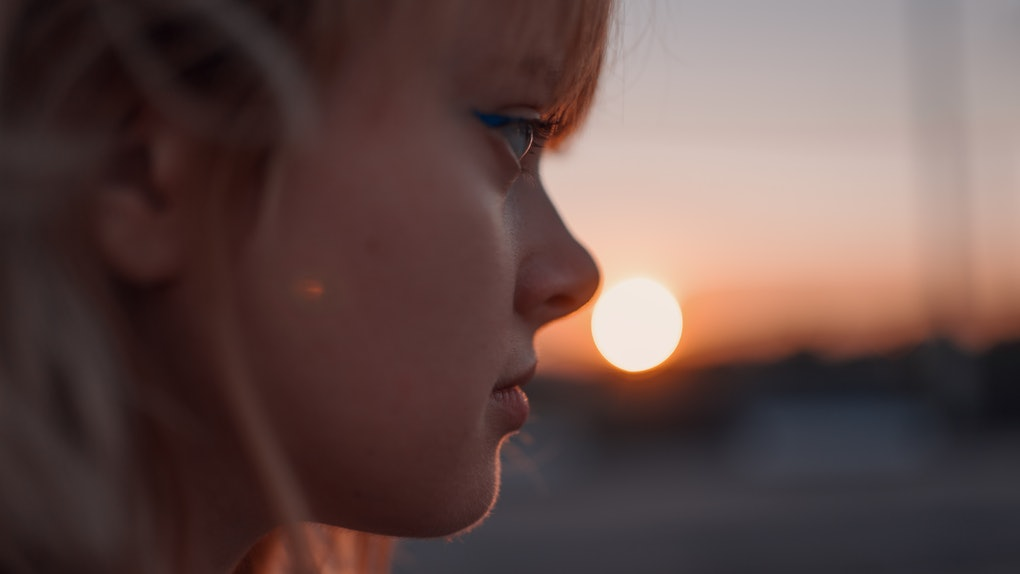 Portrait of a woman near the road at sunset