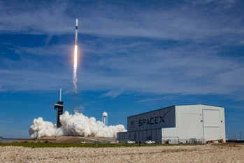 Zooming off in front of the SpaceX logo.