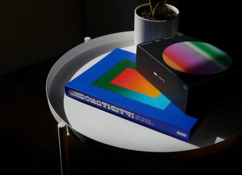 Away Chromaticity x Heretic Sensory Set on coffee table.