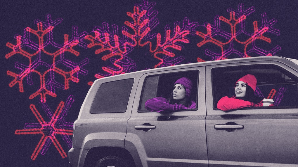 Two young women sit in a car and enjoy a drive-thru Christmas lights experience, in a purple and pink graphic with snowflakes.