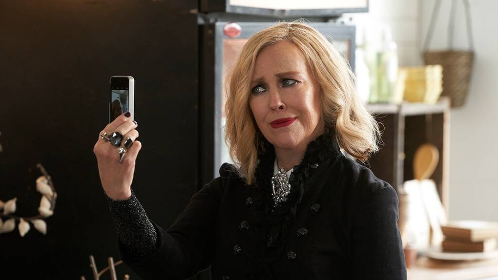 Moira (Catherine O'Hara) records an Instagram live with her phone in 'Schitt's Creek.'