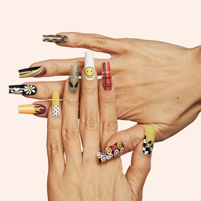 One hand lays atop another, showing off nails from the Nails By Mei and ManiMe nail sticker collection