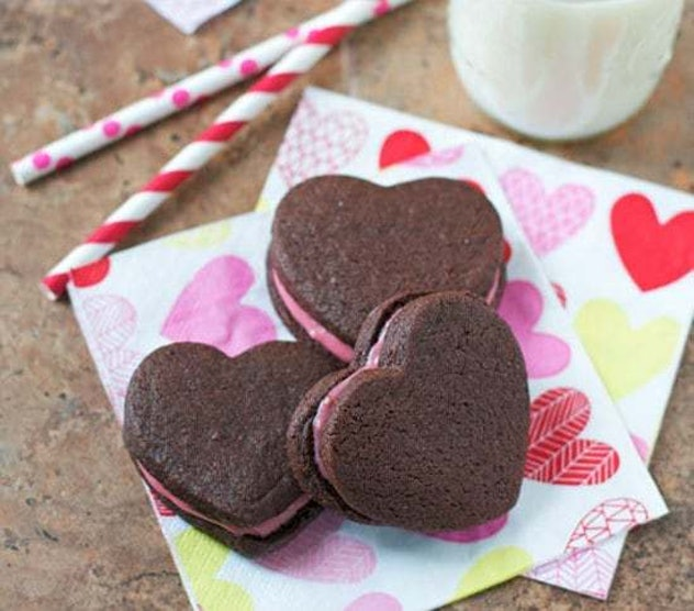 These Chocolate Sandwich Cookies make the perfect Pinterest-worthy Valentines Day recipe thanks to their pink raspberry filling.