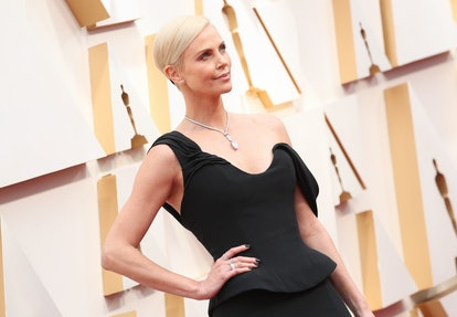 Charlize Theron wears black nail polish on the Oscars red carpet