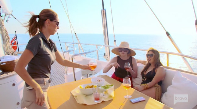 Jenna MacGillivray serves guests on Below Deck Sailing Yacht.