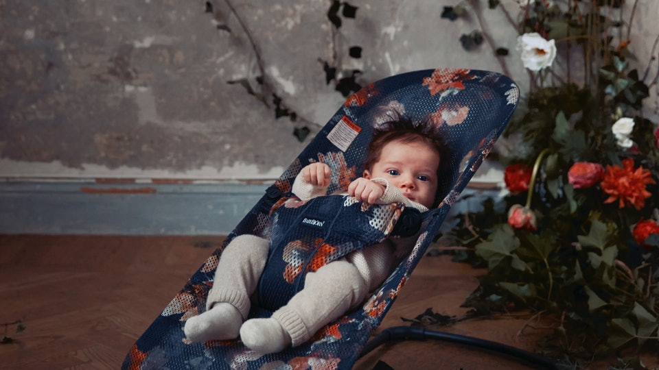 BabyBjörn's new midnight florals collection features two baby carries and a bouncer in a flower pattern.