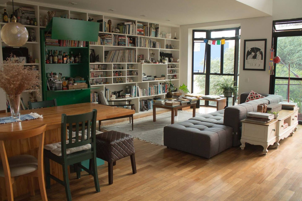 This stylish loft listed on Airbnb has bookshelves, just like the library in 'Beauty and the Beast.'
