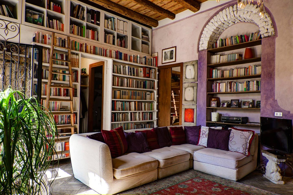 Books fill the bookshelves in the walls, just like the library in 'Beauty and the Beast,' in this ch...