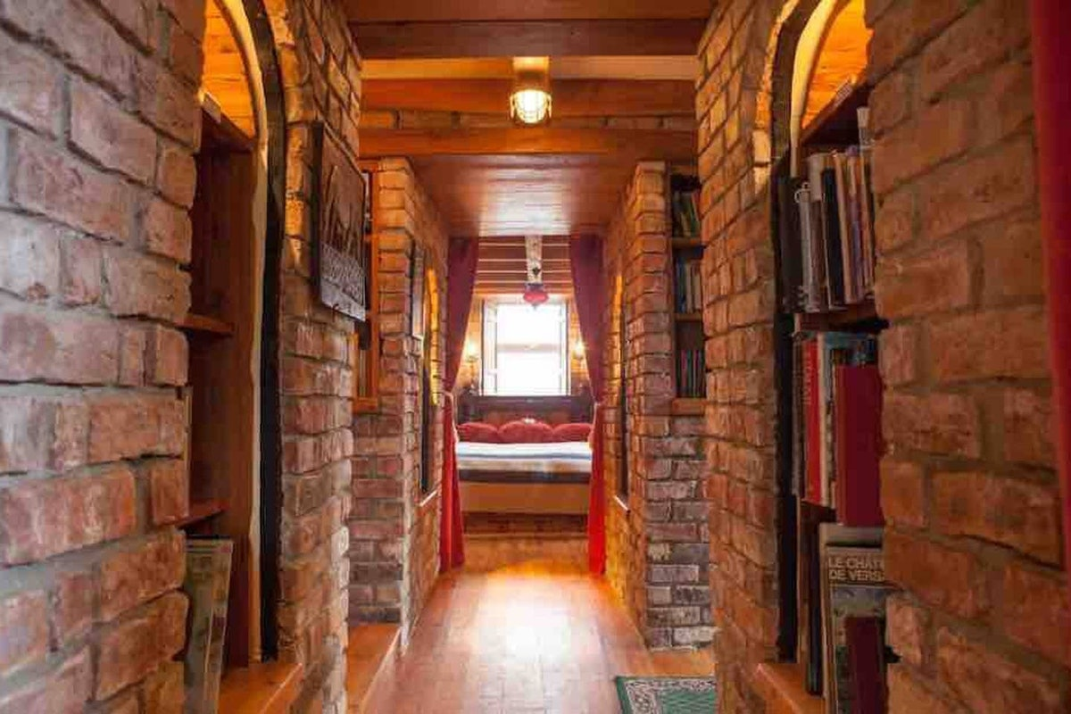 This home on Airbnb has wall-to-wall books, just like the library in 'Beauty and the Beast.'