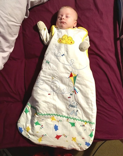 a toddler sleeps in a sleepsack