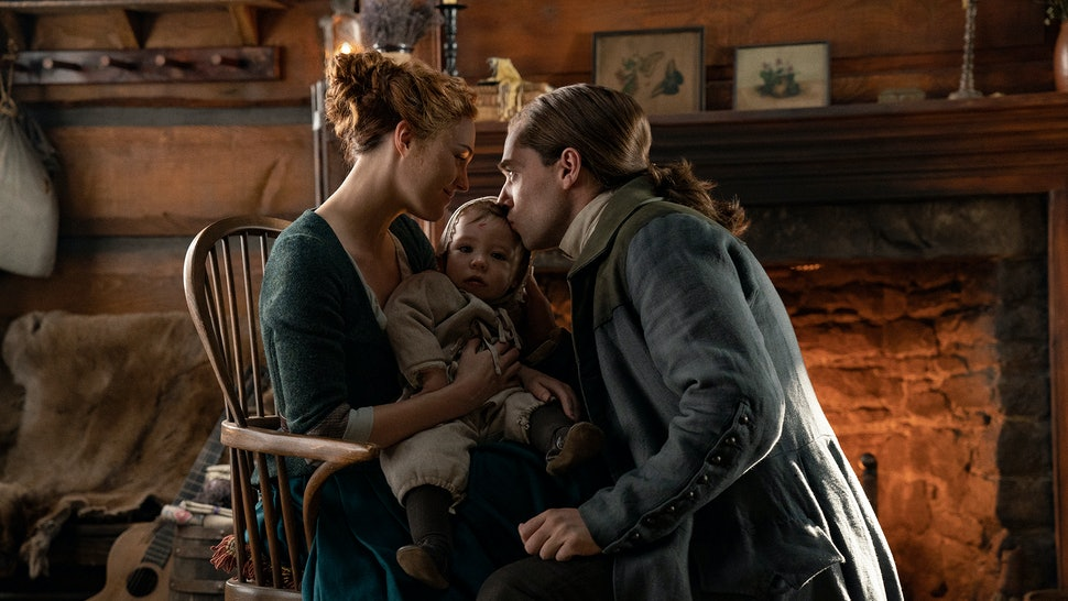 "Sophie Skelton as Brianna ""Bree"" Randall, Richard Rankin as Roger Wakefield, and their son Jeremiah in Outlander Season 5"