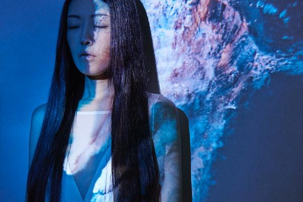 Young Asian woman, mystical Mercury retrograde
