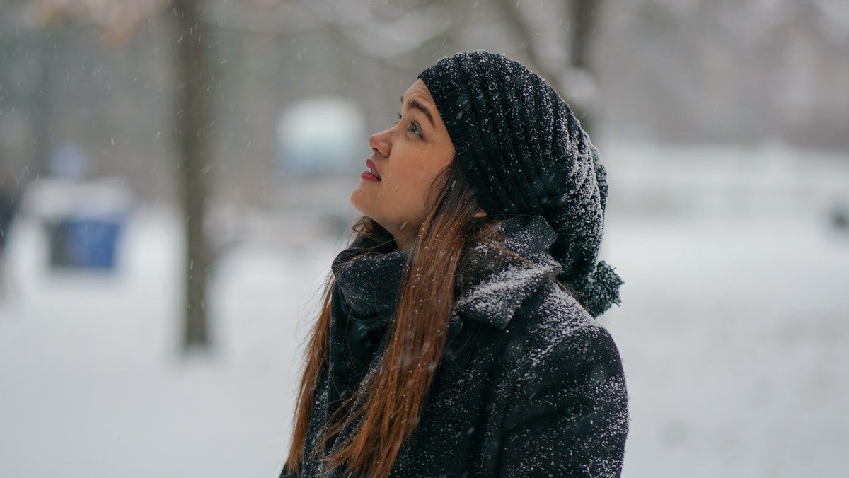 Young woman in winter snow