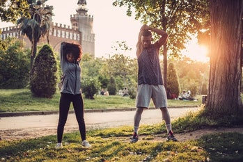 Black couple doing exercise outdoors