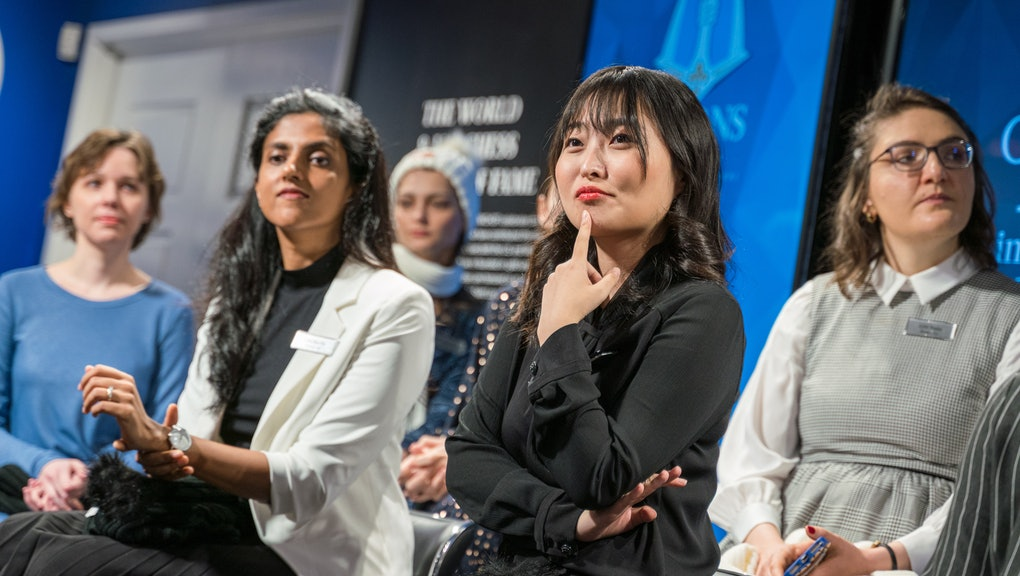 Women's World Champion GM Ju Wenjun, surrounded by her competitors at the 2020 Cairns Cup. Photo by Lennart Ootes, courtesy of the Saint Louis Chess Club