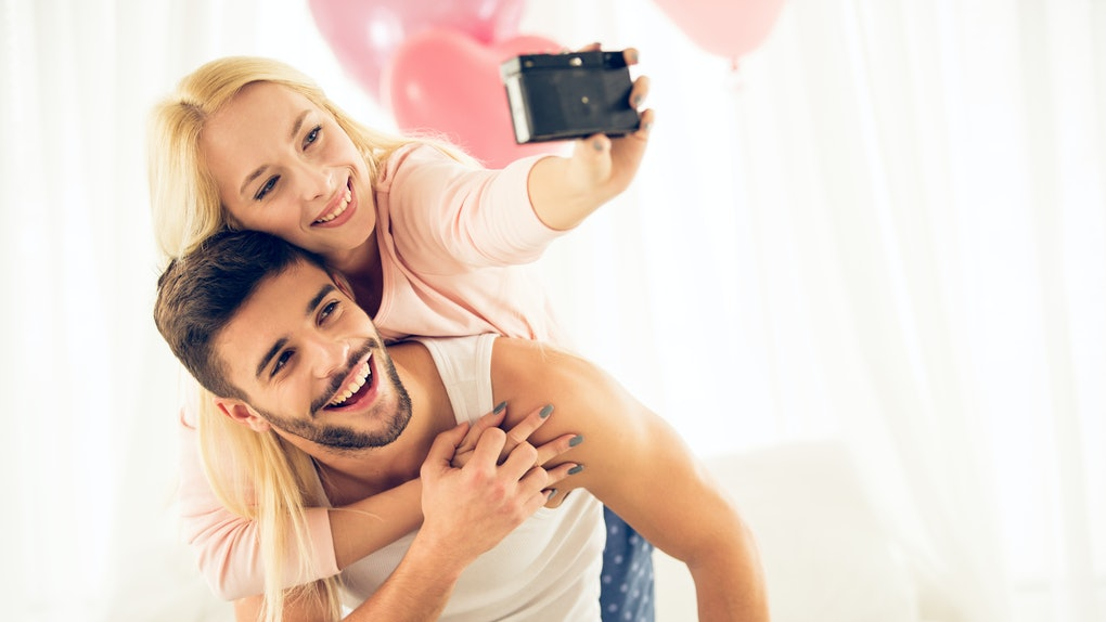 Young couple taking selfie on Valentine's Day