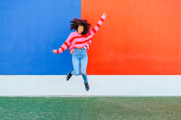Young woman leaping for Leap Year 2020