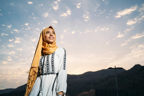 Young woman with headscarf and bright sky