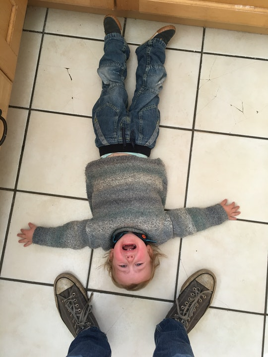 toddler throws a tantrum on floor