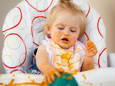 Blond toddler making a mess with food