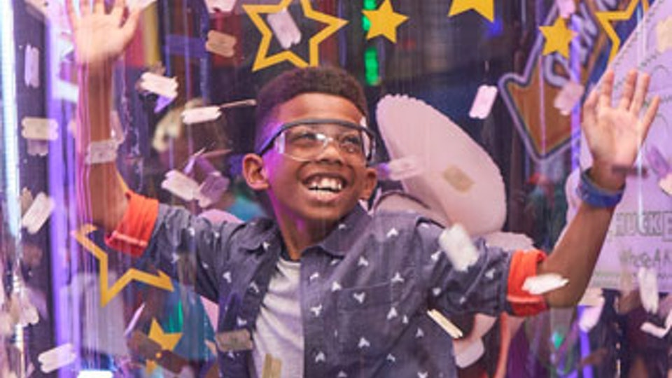 Boy plays in the wind tunnel at Chuck E. Cheese