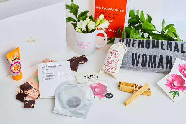 Small Packages' break-up box features tons of colorful amenities like face masks, chocolate, a mug, and a shirt.