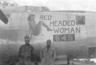 Soliders in World War 2 standing in front of a plane with racy nose art.