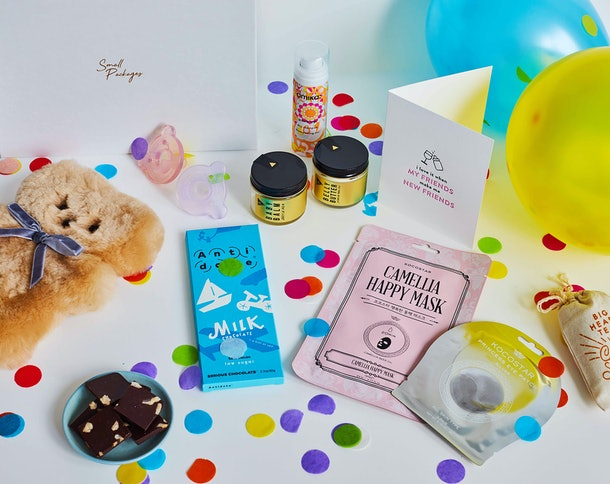 A package from Small Packages includes all kinds of celebratory goodies, chocolate, and snacks.