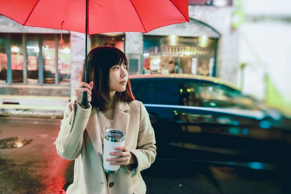Young Asian woman on rainy day