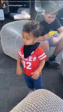 Miles dressed in a red jersey with #2
