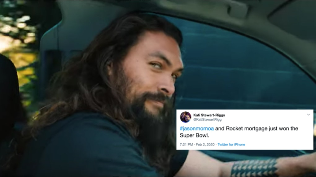 Jason Momoa drives his car and smiles on a sunny day in a Rocket Mortgage Super Bowl commercial.