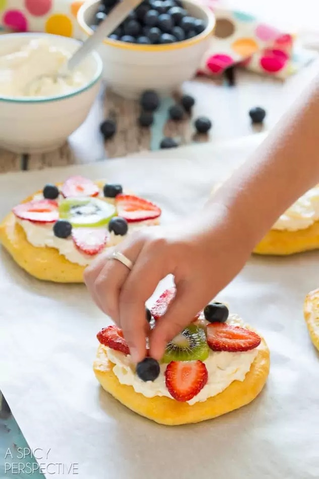 Breakfast fruit pizza is a festive Valentine's Day breakfast for kids who love toppings.