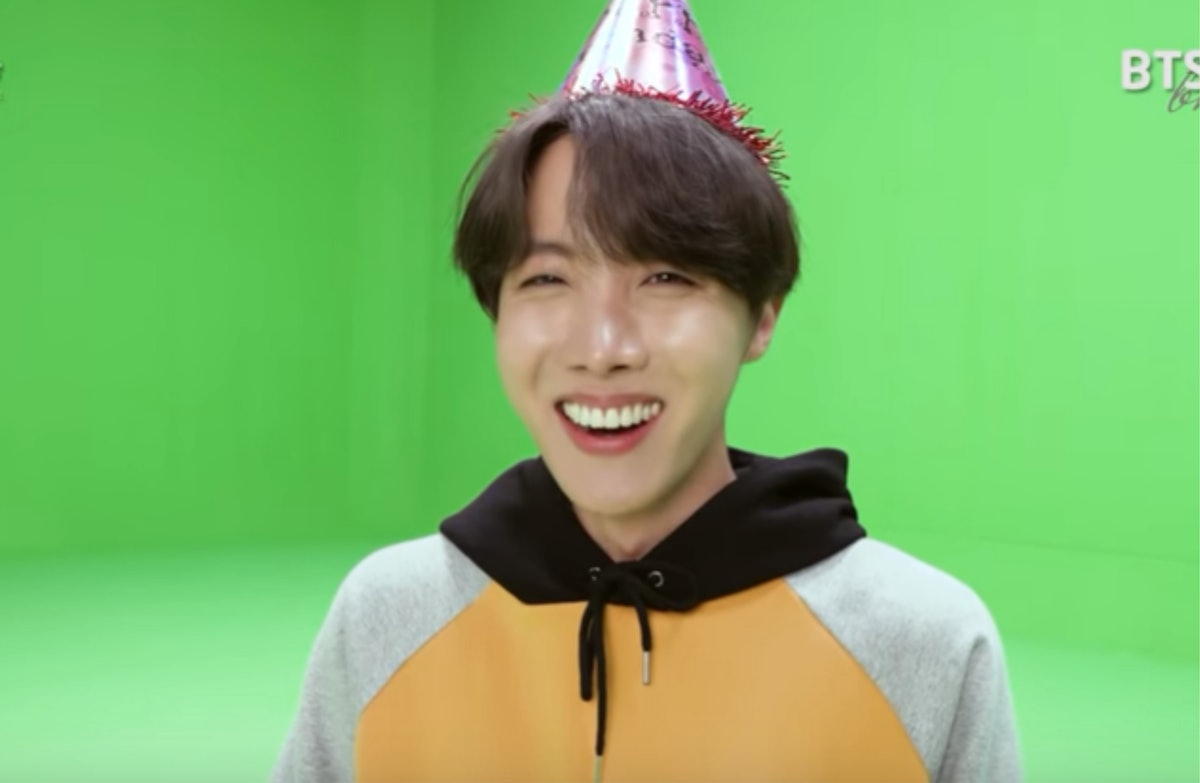 A screenshot from the video of BTS' J-Hope recreating his childhood birthday photo.