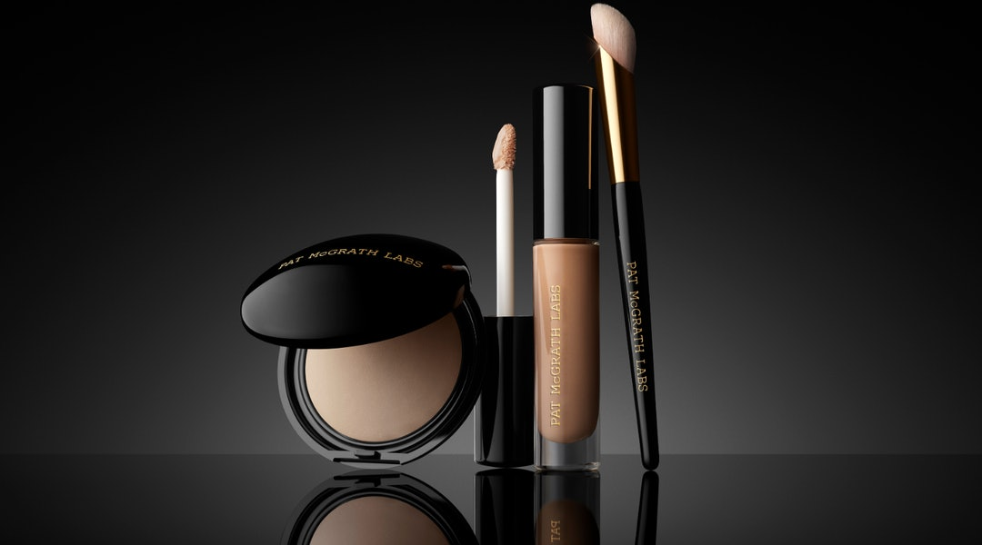 Pat McGrath Labs' Sublime Perfection Concealer System with powder, concealer, and brush.