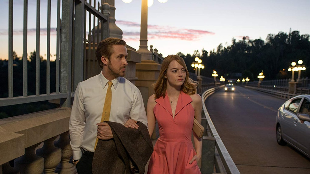 Ryan Gosling and Emma Stone walk down a street in Los Angeles during sunset in the romantic comedy 'La La Land.'
