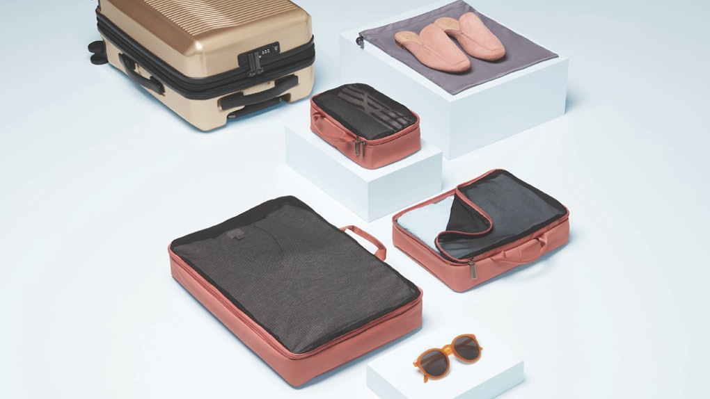 Target's Open Story luggage brand features easy-to-pack suitcases in different colors like gold and coral.