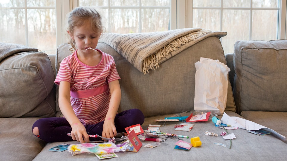 a little girl opening her valentines from school