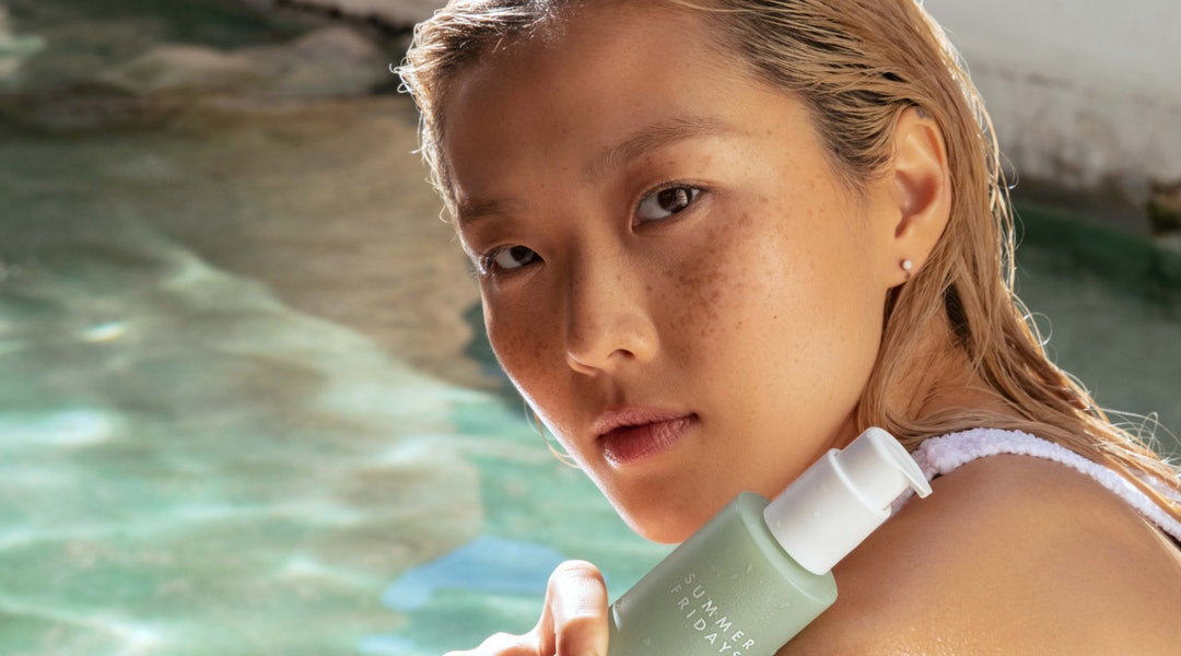 Summer Fridays' new Super Amino Gel Cleanser with model.