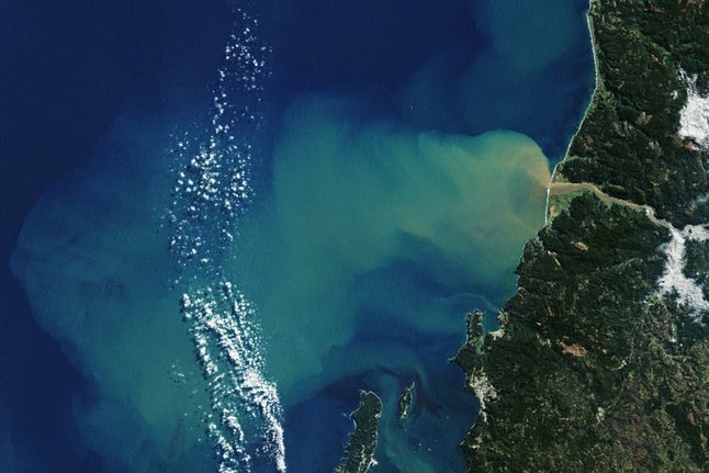 After an atmospheric river event that caused severe flooding in Chile, sediment washed down from hillsides into the Itata River can be seen flowing up to 50 kilometers from the coast.