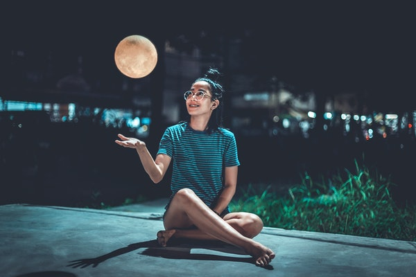 Young woman looking at supermoon