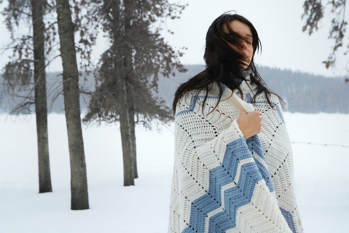 Young woman in cold winter, possibly Pisces season