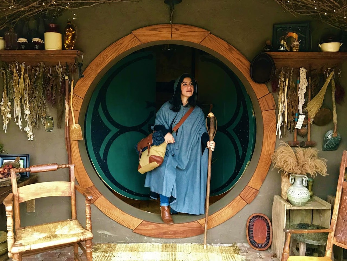 A young woman poses in 'Hobbit' attire while staying at in Airbnb in Fairfield, Virginia.